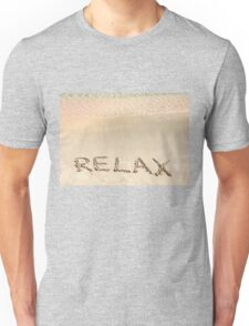 Relax word written in the sand, on a beautiful beach with clear blue waves in background Unisex T-Shirt