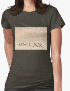 Relax word written in the sand, on a beautiful beach with clear blue waves in background T-Shirt