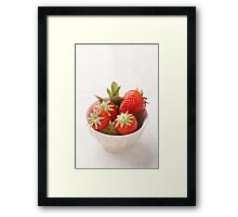 Strawberries in a bowl Framed Print