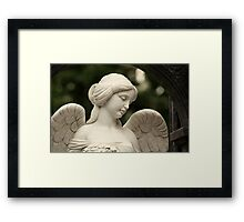 angel with a female face Framed Print