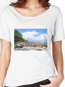 Beautiful tropical beach with white sand blue waters and colorful rocks Women's Relaxed Fit T-Shirt