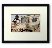 Soldier watching with Hummer Framed Print