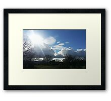 Sunshine breaking through the clouds Framed Print