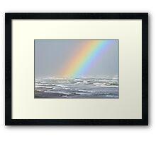 Rainbows and rough seas Framed Print