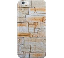 Detail of a decorative wall of jagged limestone tiles iPhone Case/Skin