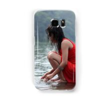 woman wearing a red dress sitting on the edge of the river Samsung Galaxy Case/Skin