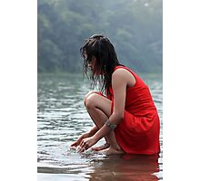 woman wearing a red dress sitting on the edge of the river Photographic Print