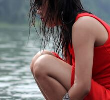 woman wearing a red dress sitting on the edge of the river Sticker