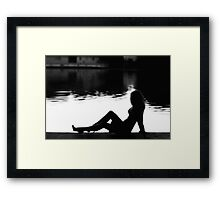 Silhouette woman siting near the lake  Framed Print