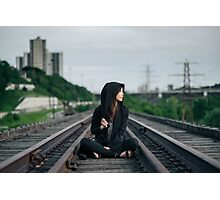 woman sitting on train tracks Photographic Print