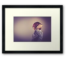 woman styling her hair Framed Print