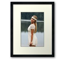Blonde girl wearing a white dress near lake II Framed Print