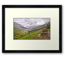 A bench with a view Framed Print