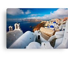 Oia embracing the Caldera Canvas Print