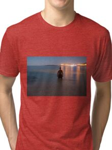 Man in sea watching the view at night Tri-blend T-Shirt