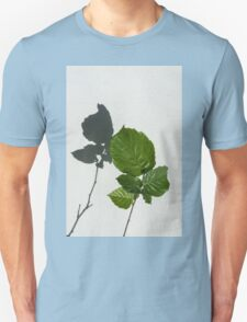 Sophisticated Shadows - Glossy Hazelnut Leaves on White Stucco - Vertical View Upwards Left  Unisex T-Shirt