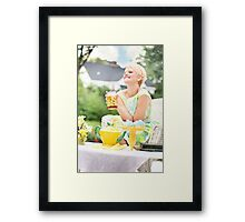 Blonde woman at a party food Framed Print