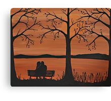 Couple sitting on a bench Canvas Print