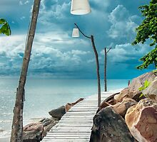Empty wooden pier on tropical island by Stanciuc