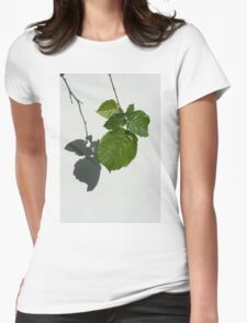 Sophisticated Shadows - Glossy Hazelnut Leaves on White Stucco - Vertical View Down Left  Womens Fitted T-Shirt