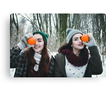 two hipster  girls playing in winter  Canvas Print
