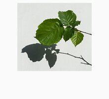 Sophisticated Shadows - Glossy Hazelnut Leaves on White Stucco - Horizontal View Left Upwards Unisex T-Shirt