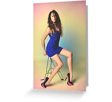 Girl sitting on a chair with a colored background Greeting Card