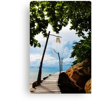 Empty wooden pier on tropical island Canvas Print