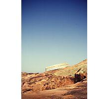 Rainbow rocks and boats Photographic Print