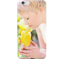 Young woman is yellow tulips flowers in the city iPhone Case/Skin