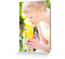 Young woman is yellow tulips flowers in the city Greeting Card