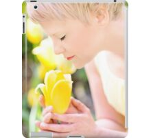 Young woman is yellow tulips flowers in the city iPad Case/Skin