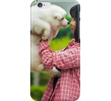 woman with a puppy in her hand iPhone Case/Skin