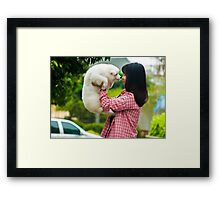 woman with a puppy in her hand Framed Print