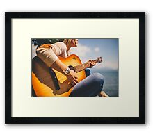 Woman playing guitar Framed Print