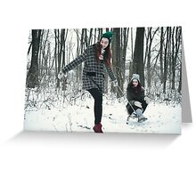 Two women are playing in the snow Greeting Card