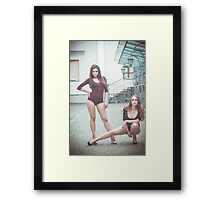 Fashion shoot of two young sexy striptease dancer Framed Print