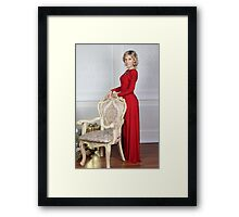 old woman in a red dress Framed Print