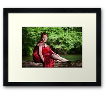 woman wearing a red dress on the river Framed Print