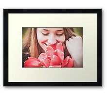 Happy woman with red flowers Framed Print