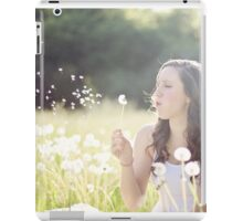 Beautiful girl playing with flowers iPad Case/Skin