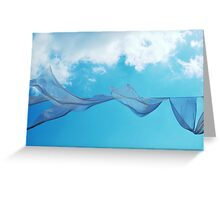 Cloth in the wind against the blue cloudy sky. Greeting Card