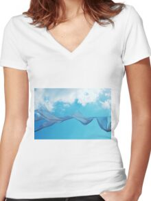 Cloth in the wind against the blue cloudy sky. Women's Fitted V-Neck T-Shirt