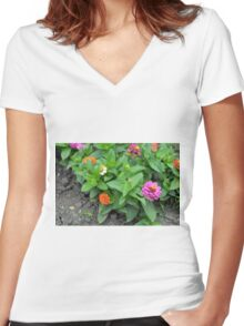 Colorful pink and orange flowers in green leaves bush in the garden. Women's Fitted V-Neck T-Shirt