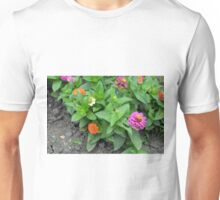 Colorful pink and orange flowers in green leaves bush in the garden. Unisex T-Shirt