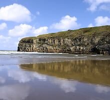 Ballybunion beach and cliffs wth Atlantic waves by morrbyte