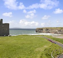 beautiful view of Ballybunion cliffs castle and beach by morrbyte
