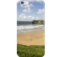view of lone man at beach and cliffs in Ballybunion iPhone Case/Skin