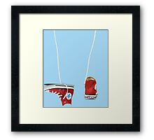 Sneakers tossing Framed Print