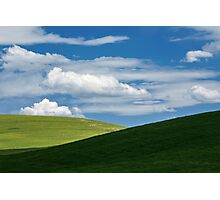 White clouds above green hills Photographic Print